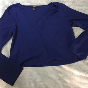 Blue long sleeve blouse with cross cross chest